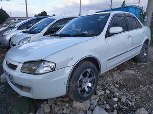 Mazda Familia 2004 White   Cars for sale in Nairobi, Komarock